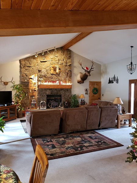 Open living room with rock fireplace