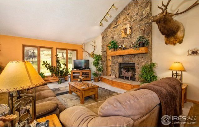 Large picture windows, And vaulted ceilings greet you as you enter this beautiful home