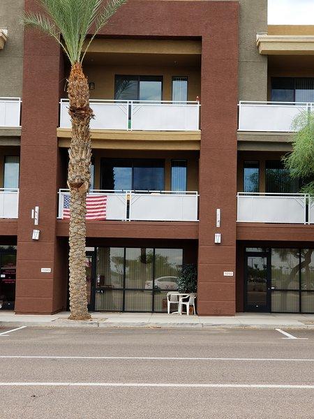 Front of condo facing Coyote Blvd. level 1/studio,level 2 ..1/2bath kitchen, living room. Balcony!