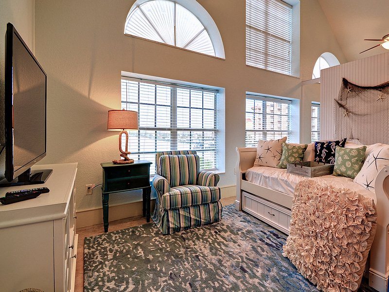 Nautical style upstairs living room with trundle day bed.