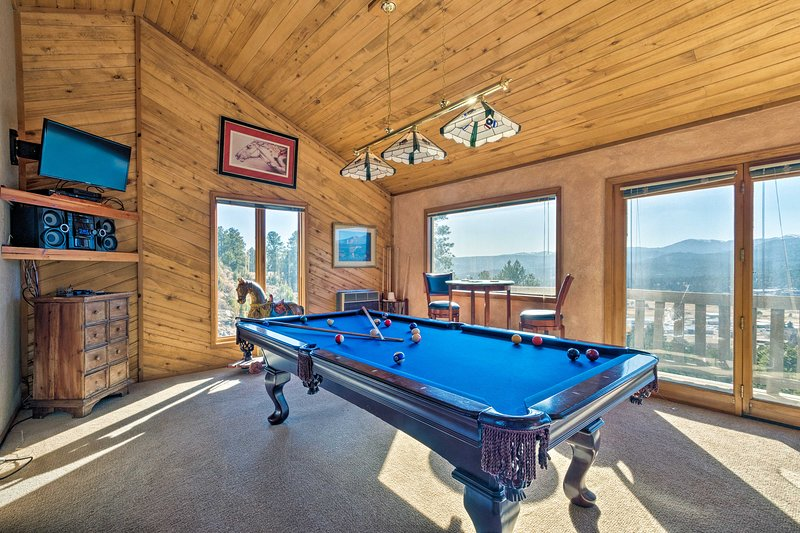 The house boasts stunning views, a game loft, a hot tub and a wraparound deck.