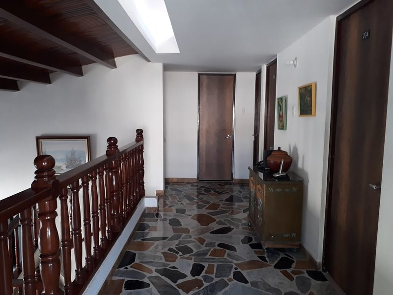 Hallway on the second floor that connects the balcony of hammocks with the rooms