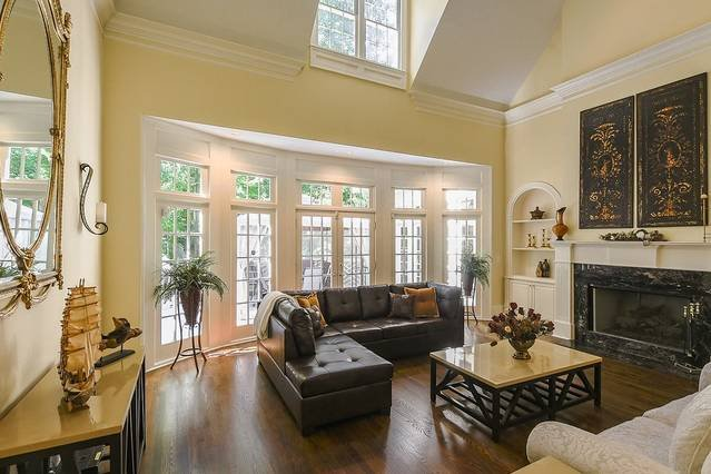 A bit tired? Presenting a luxurious living room with comfortable sofa and stylish design. Enjoy the great view through the window and yet stay warm inside with the fireplace in the winter or cold in the summer and yet enjoy tons of natural light.