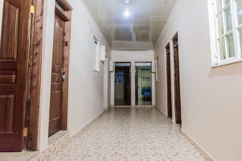 Hallway to 8 separate studio apartments.