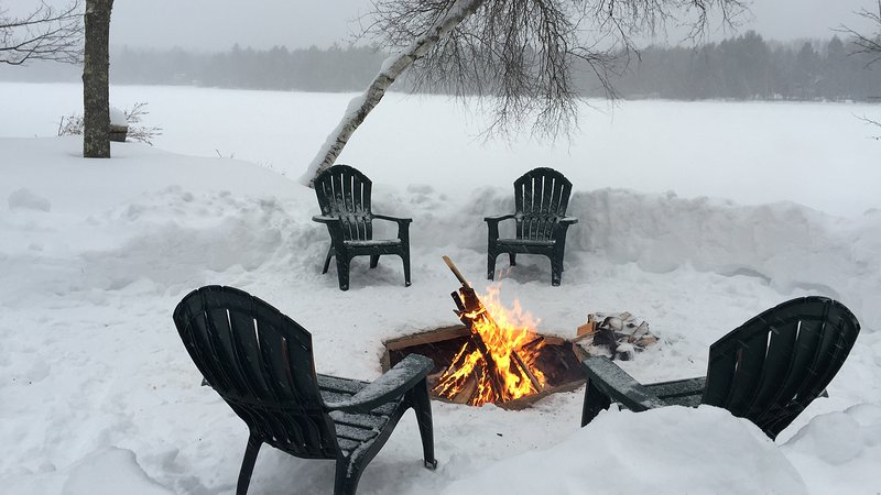 Enjoy an outdoor fire in front of the frozen lake.