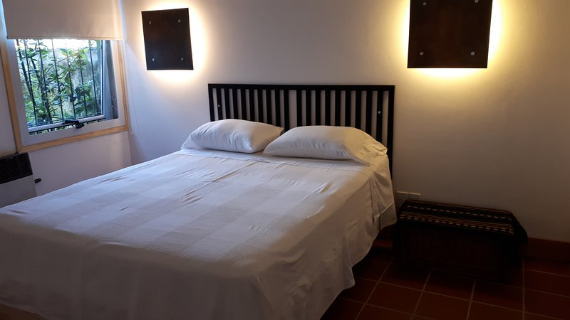 Queen bed room on the ground floor