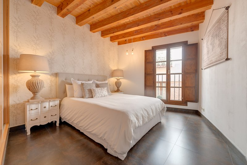 Master bedroom with balcony overlooking the steps of the Holy Week processions