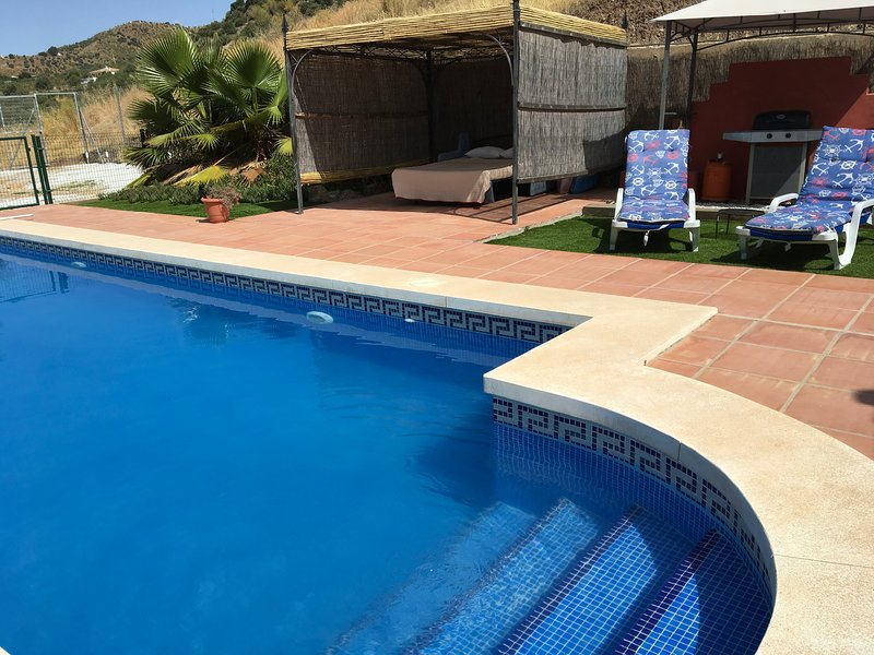 9x4 pool and shaded gazebo