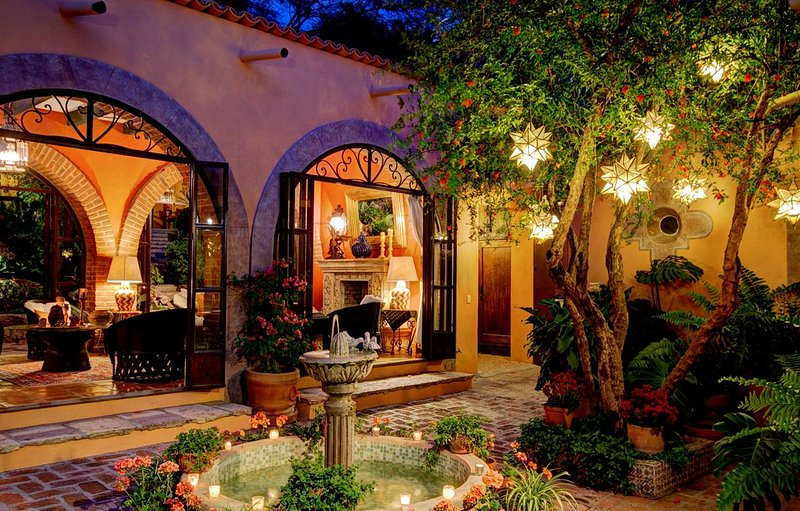 Living room and courtyard at night.