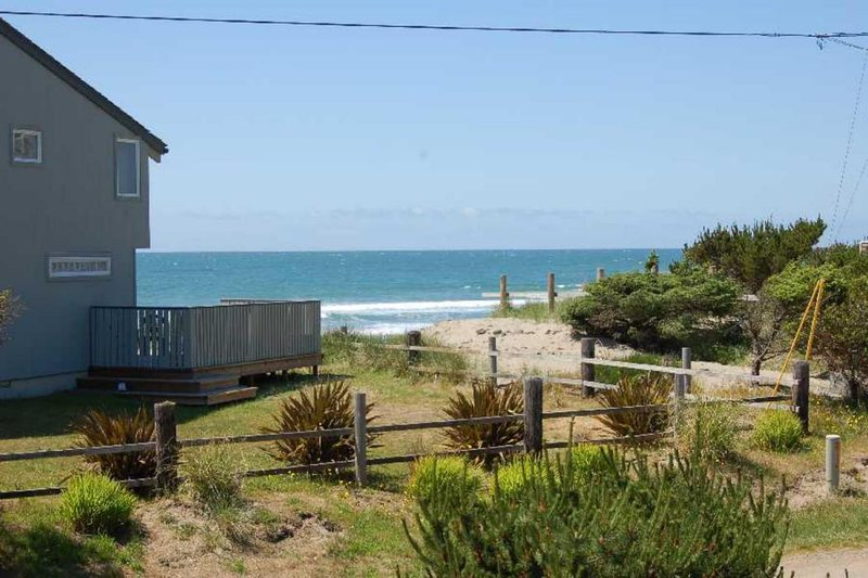 An ocean view from the deck and livingroom.   Four bedroom home across from the beach access.