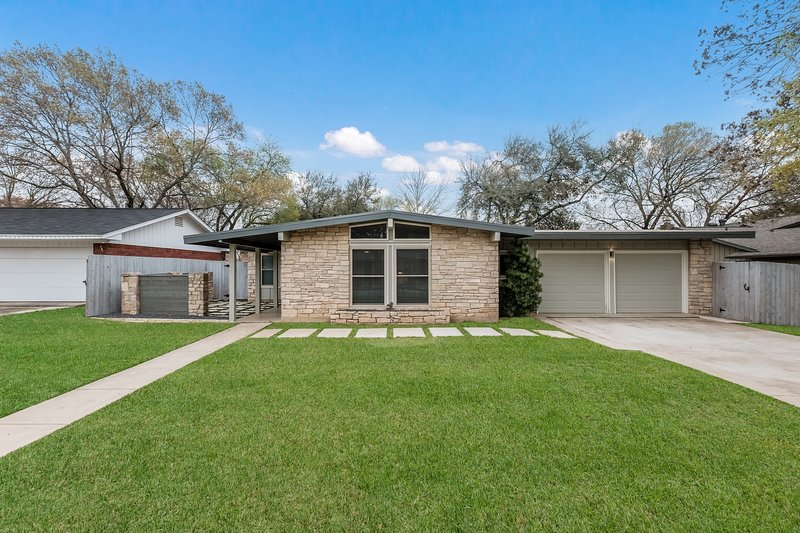 Stunning curb appeal with mid century character.