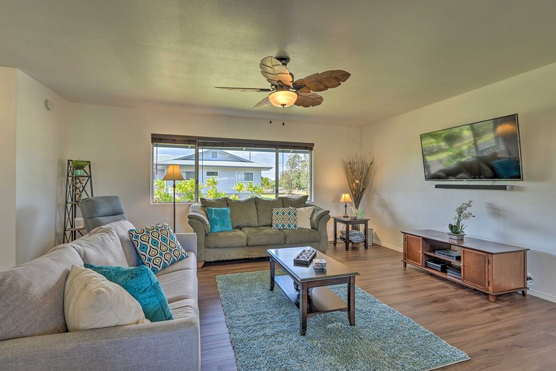 Find your Hawaiian paradise waiting at this beautiful Keaau vacation rental!