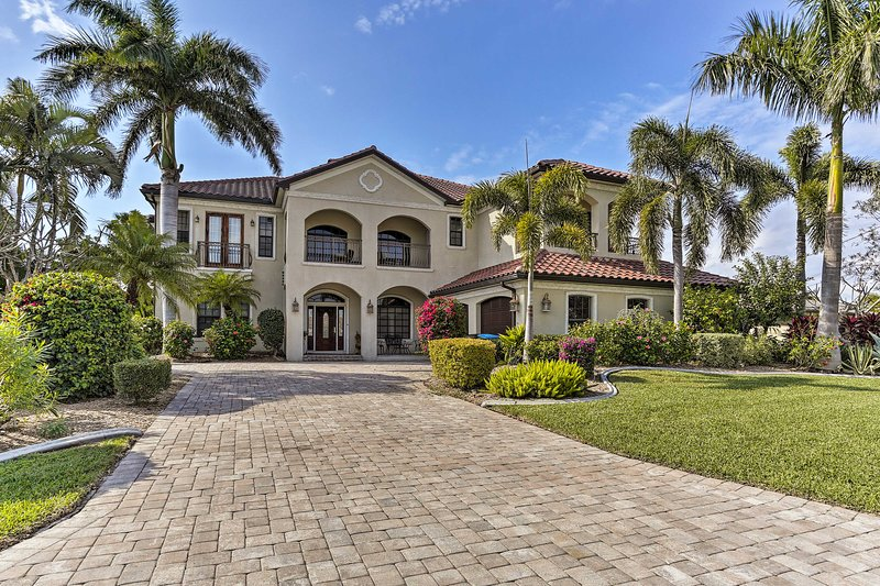Discover bliss at this 4-bedroom, 3.5-bath canal-front home in Cape Coral!
