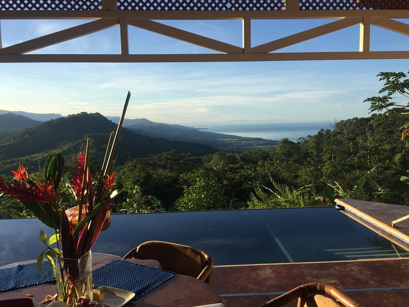 Panoramic pool-side views of multiple mountain ranges and Pacific Ocean to Osa Peninsula