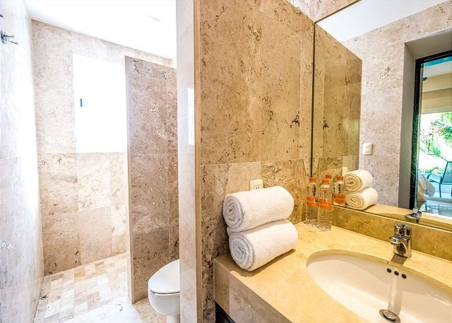 Guest bathroom with a shower and bath products provided