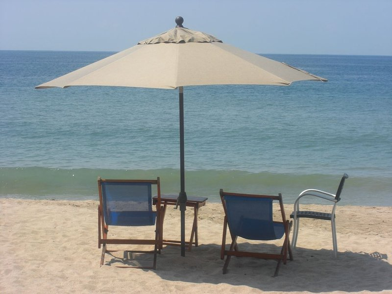 the blue chairs and the beach are awaiting you!!