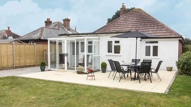 Rear garden with level patio and BBQ space