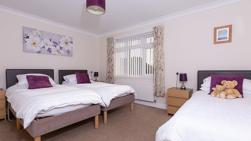 Family room with three single beds. Optional king size double available