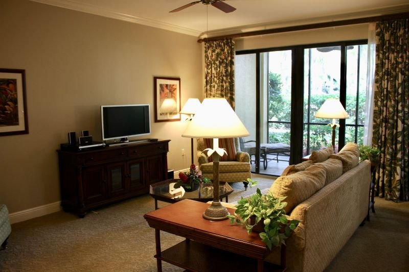 Nicely appointed living room with a seating area and balcony