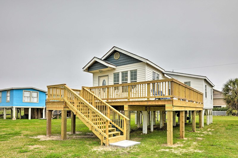 The cottage provides a large wraparound deck.