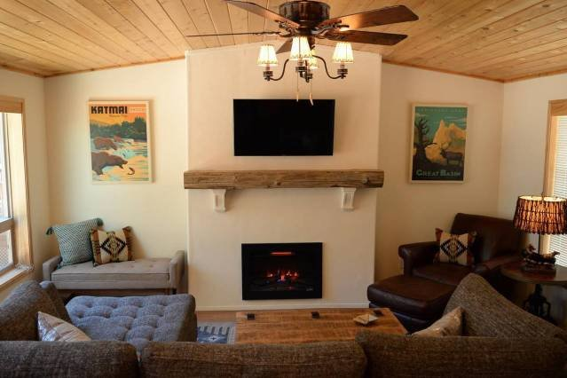 The Living Room features a sectional sofa, weathered leather chair, (electric) fireplace, and 40' Smart TV with Dish Network.  Bring your passwords and enjoy Netflix, Hulu, and more!