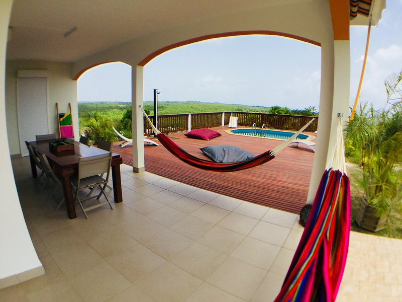 8 seater outdoor table and hammocks