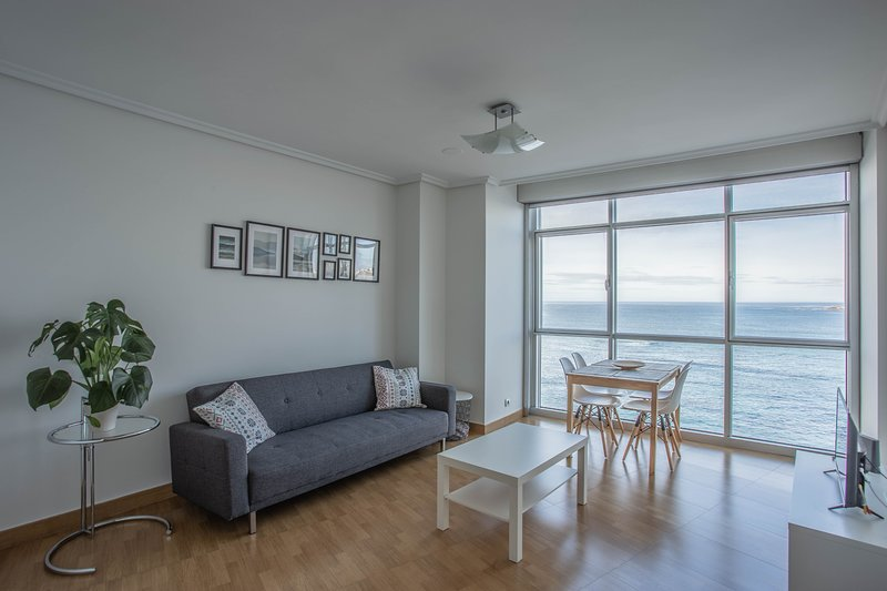 Living room with views to the beach of Riazor