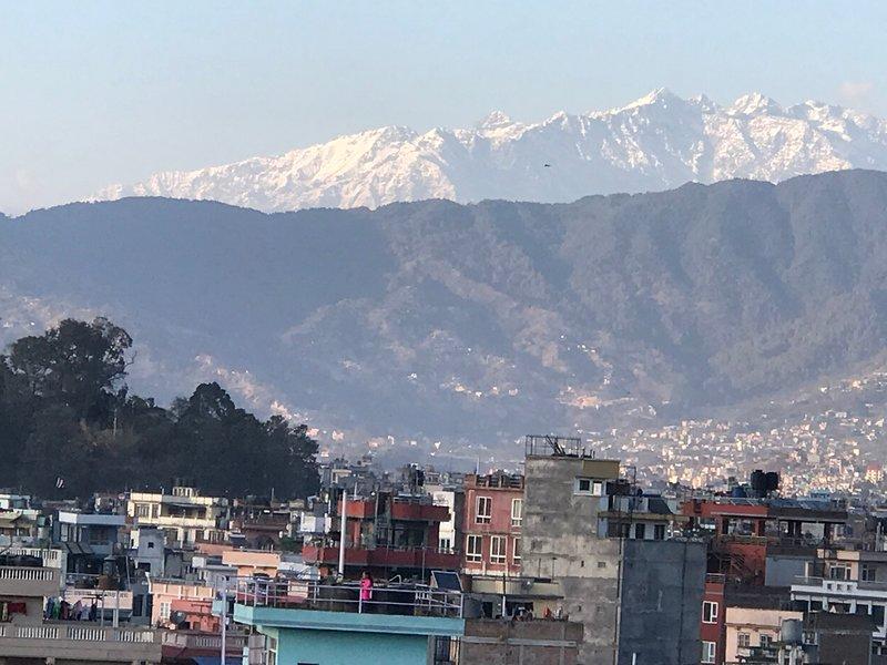 Uitzicht op de Himalaya vanaf het dak