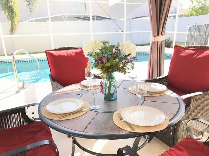 Enjoy dining by the pool under the gazebo.