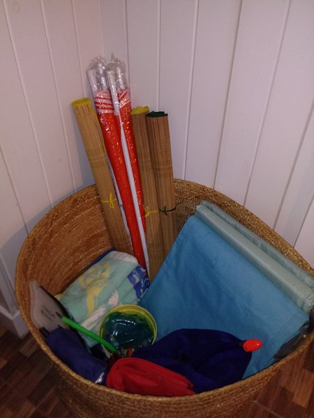 Beach ammenities: beach umbrellas, mat, towels, mini beach sand table, insulated tote bag.