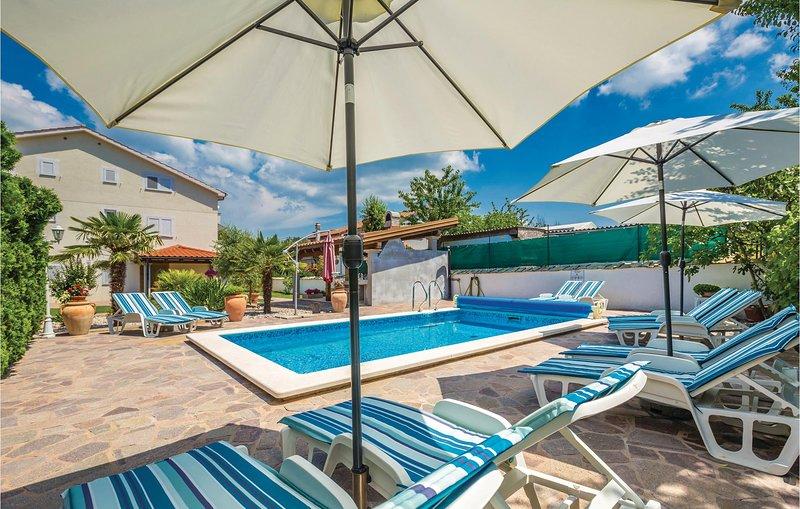 Nice home in Malinska with WiFi and 0 Bedrooms (CKK877), location de vacances à Sveti Anton