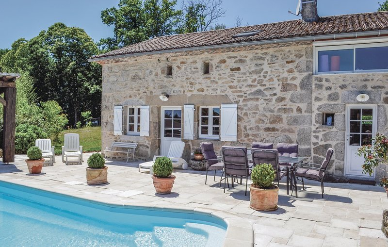 Awesome home in Augignac with Outdoor swimming pool and 3 Bedrooms (FAD733), vacation rental in Marval