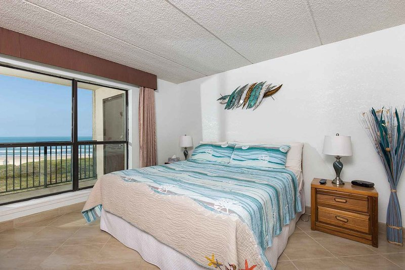 The master bedroom has a king-size bed and a great view!