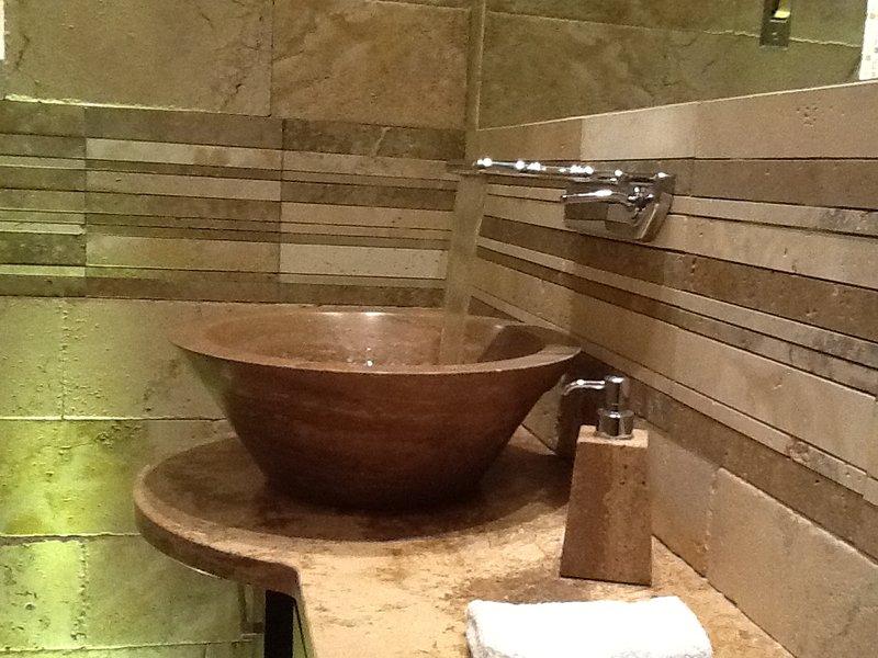 The luxury exclusive private bathroom in precious Italian travertine marble