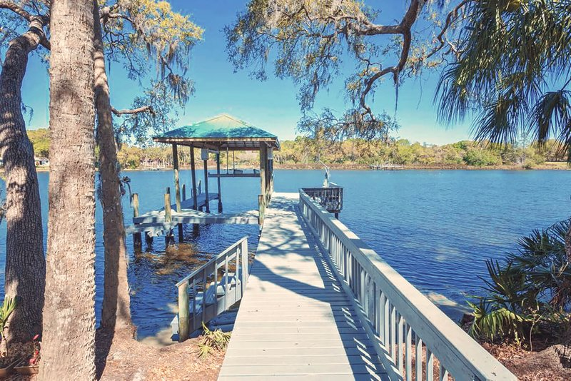 The dock. Enjoy use our kayaks, paddle boards and fishing poles.