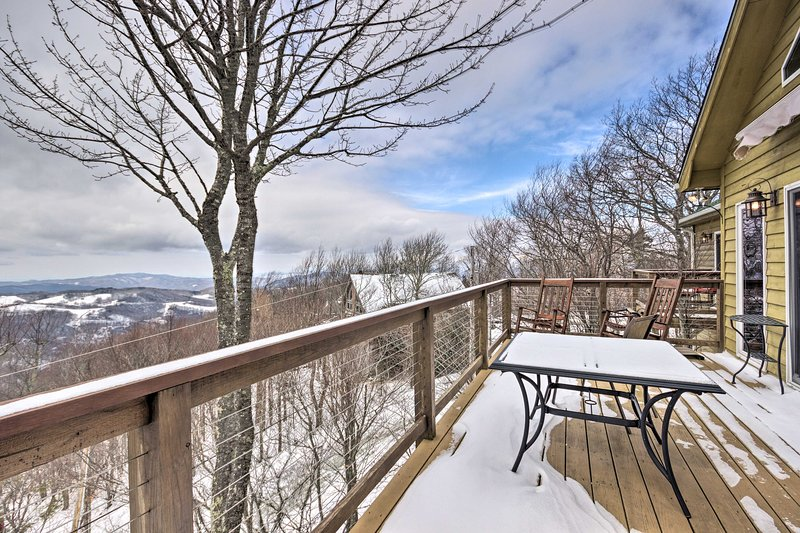 The 4-bed, 3-bath house features a deck and covered patio viewing the mountains.