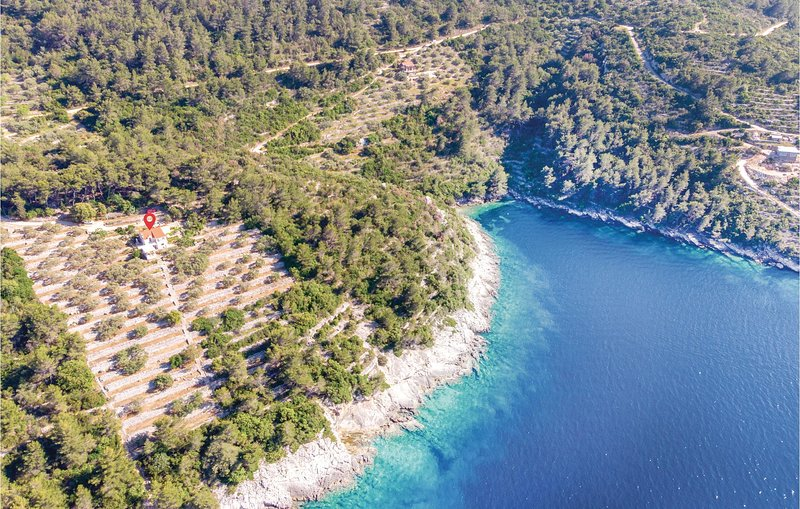 Nice home in Vela Luka with 4 Bedrooms (CDS265), holiday rental in Potirna