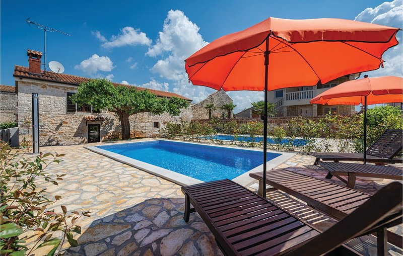 Amazing home in Porec with WiFi and 2 Bedrooms (CIE394), holiday rental in Rosini