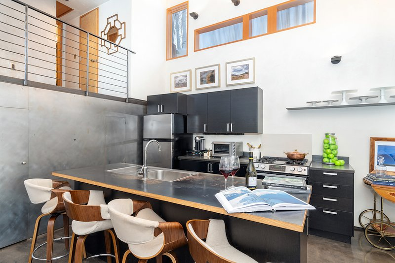 The kitchen is fully equipped for preparing meals, and also has a Nespresso machine!