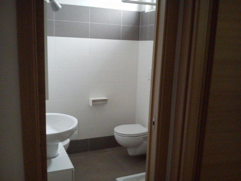 Bathroom with shower, sleeping area