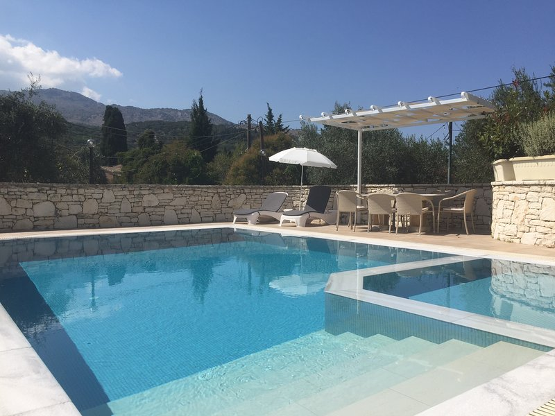 Top luxury villa in peaceful central location in Kassiopi. Sea & mountain views, holiday rental in Kassiopi