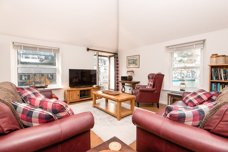 Lovely bright double aspect lounge with views of Looe quay and harbour
