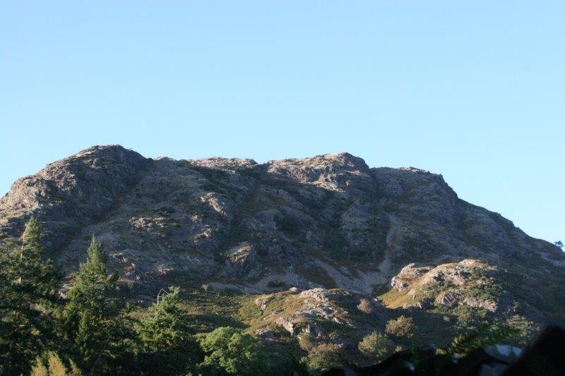 The imposing view of Yewdale Crags above the Village