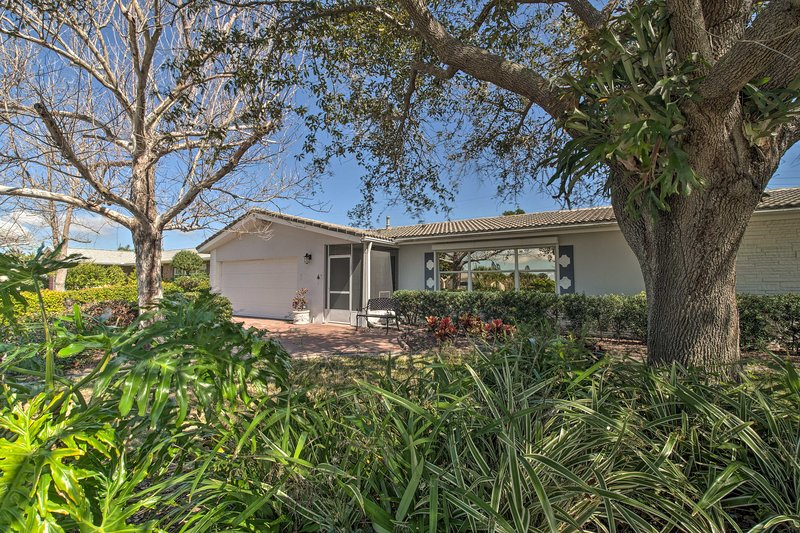 This vacation rental is nestled between Banana River and the beach.