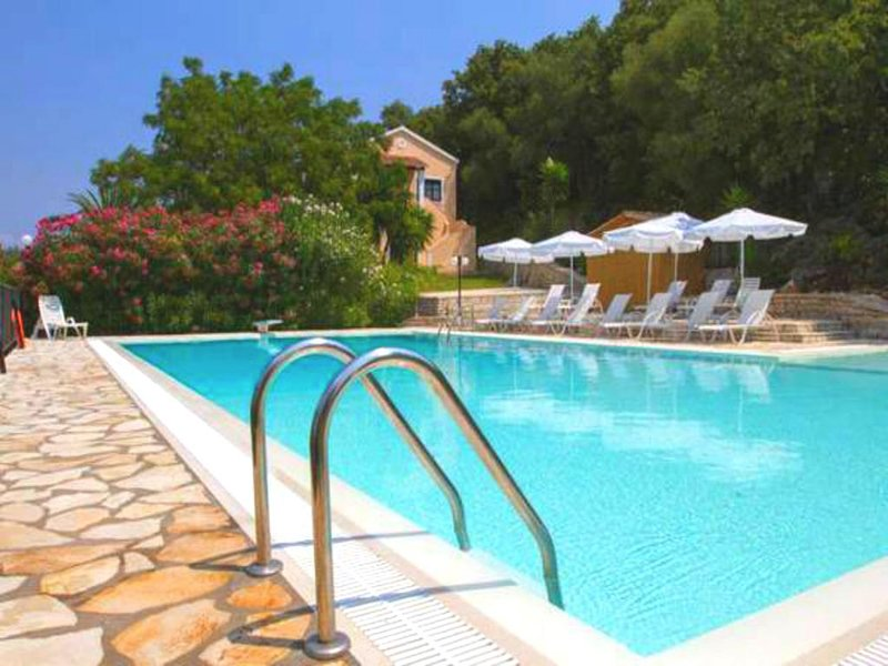 Relax around the pool overlooking the Ionian Sea