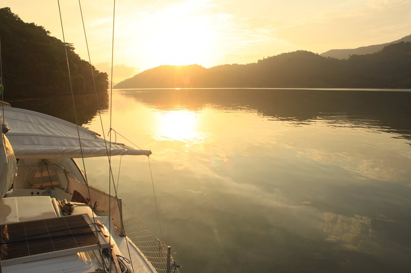 Sunset in the Bag of Fundão in Paraty Mirim, very calm waters ideal for sleeping on board.