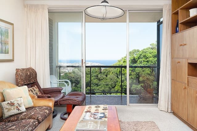 Living room opens up to a Balcony + view