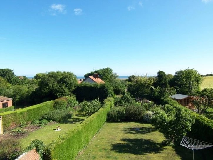 View from upstairs window towards the sea