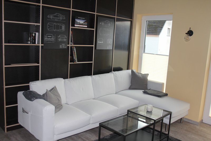 The modern living room invites you to relax