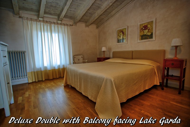 DELUXE DOUBLE WITH PRIVATE BALCONY AND LAKE GARDA VIEW